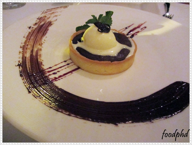 """70% hot dark chocolate tart """"crostata"""" with milk ice cream"""